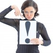 Beautiful businesswoman with a sign exclamation mark. Isolated on a white background. — Stock Photo #12148342
