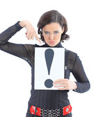 Beautiful businesswoman with a sign exclamation mark. Isolated on a white background. — Stock Photo