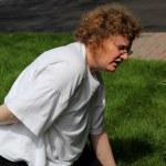 Woman backache during gardening — Stock Photo #11388205