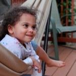 Happy little girl in hammock — Stock Photo