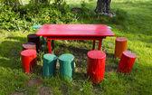 Colorful rural garden furniture — Stock Photo