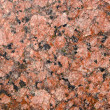 Red granite macro background — Stock Photo
