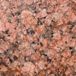 Red granite macro background — Stock Photo