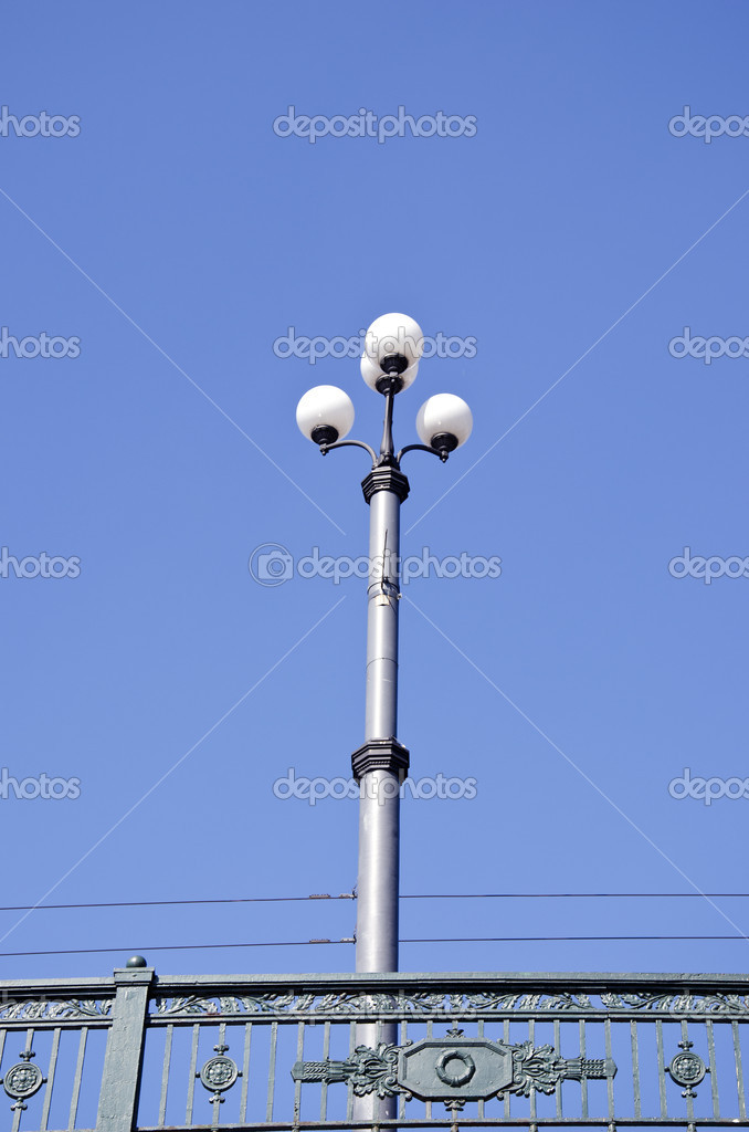 Vintage street lamp and brigge rails on sky background — Stock Photo #11390083