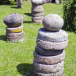 Stone and millstone collection in the yard — Stock Photo #11661189