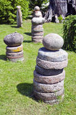 Stone and millstone collection in the yard — Stock Photo