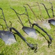 Stock Photo: Old historical metal ploughs on gras