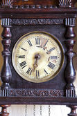 Antique and broken wooden clock dial — Stock Photo