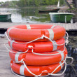 Group red life buoy on lake bridge — Stock Photo