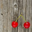 Two red cherry berry on wooden background — Stockfoto