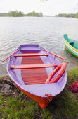 Colorfull spring boat on lake — Stock Photo