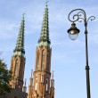 Church towers and street lamp in Warsaw — Stock Photo