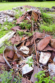 Rusted scrap-iron on farm grass — Foto de Stock