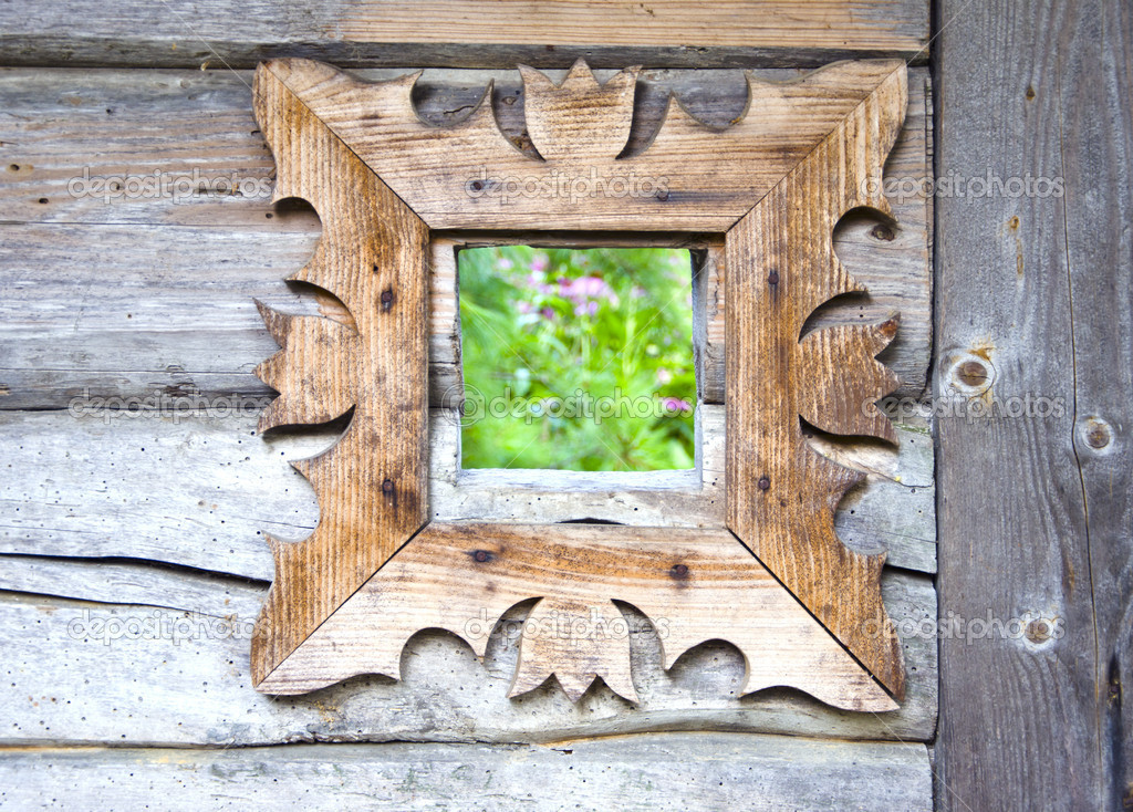 Decorative wooden window in old farm — Stock Photo #12266547