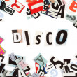 Stock Photo: Disco inscription made with cut out letters