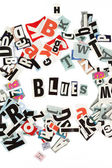 Blues inscription made with cut out letters — Stock Photo