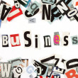 Business inscription made with cut out letters - Stock Photo