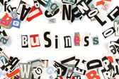 Business inscription made with cut out letters — Stock Photo