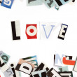 Stock Photo: Love inscription made with cut out letters