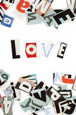 Love inscription made with cut out letters — Stock Photo