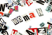 Woman inscription made with cut out letters — Stock Photo