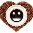 Coffee cup on heart from beans of coffee — Stock Photo #11944421
