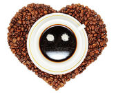 Coffee cup on heart from beans of coffee — Foto Stock