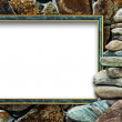 Frame for a photo with a cairn on a stone background — Stock Photo