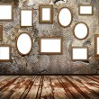 Stock Photo: Picture frames on stone grange background