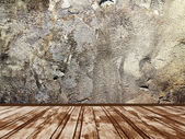 Interior of a room with a wall of stone — Stock Photo