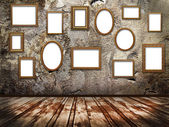Picture frames on a stone grange background — Stock Photo