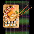 Japanese sushi traditional Japanese food. Roll made of Smoked — Stock Photo #11036030