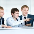 Young business man discussing project with his colleagues and po — Stock Photo #11687519