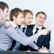 Young business man discussing project with his colleagues and po — Stock Photo #11687531