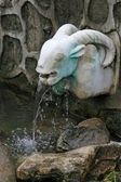 Water outlet of the sheep head modelling in a park in China — Stock Photo