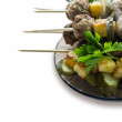 Background with roast meatballs on skewers — Stock Photo