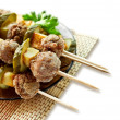 Roast meatballs on skewers — Stock Photo
