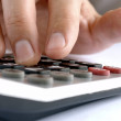Hand and a calculator — Stockfoto