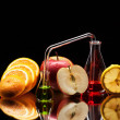Laboratory glassware with fruits — Stock fotografie