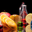 Laboratory glassware with fruits - Stock Photo