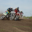 Group Motocross  racer the first corner after the start — Photo