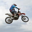 The spectacular jump motocross racer — Stock Photo