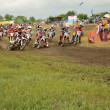 Motocross  racer the first corner after the start — Stock Photo