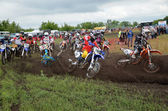 Start holeshot parts, crash the motocross group of riders the MX — Stock Photo