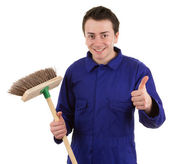 A worker holding a broom — Stock Photo