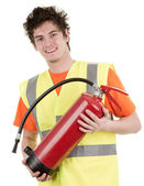 Man with a fire extinguisher — Stock Photo