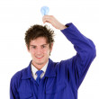 Workman with a bulb — Stock Photo