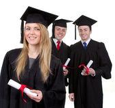 Three graduates — Stock Photo