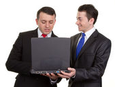 Two businessmen with a computer — Stock Photo