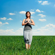 Woman practicing yoga at sunny day — Stock Photo